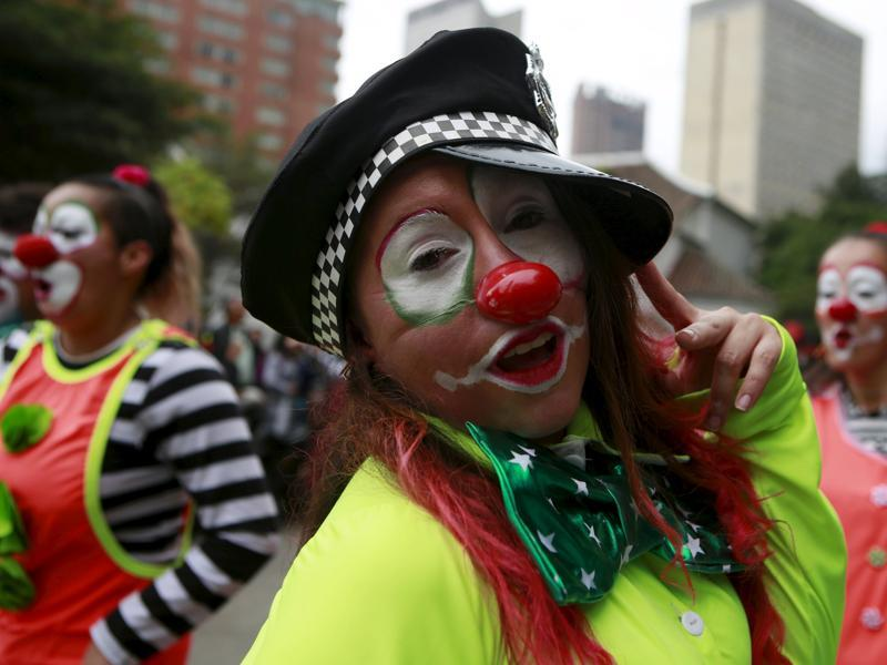 Clowns perform in a street parade as part of the opening ceremony of the Ibero-American Theatre Festival in Bogota, Colombia. (Reuters)