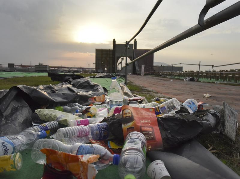 Garbage piles up at the site of the Art of Living's World Culture Festival on the Yamuna riverbed in Delhi. The controversial three-day festival ended on Sunday. Green groups accused the festival's organisers of ripping up vegetation and ruining the river's fragile ecosystem by damaging its bed and disrupting water flows. (Sushil Kumar/ HT Photo)