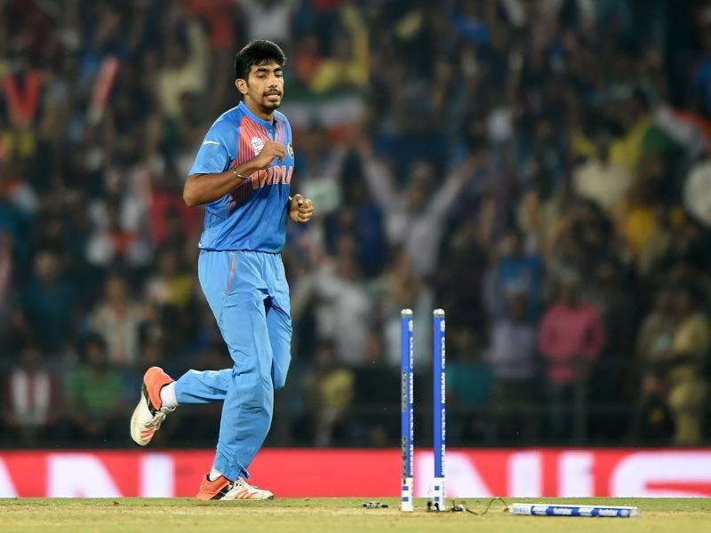 India's Jasprit Bumrah celebrates after bowling Corey Anderson out. (AFP Photo)