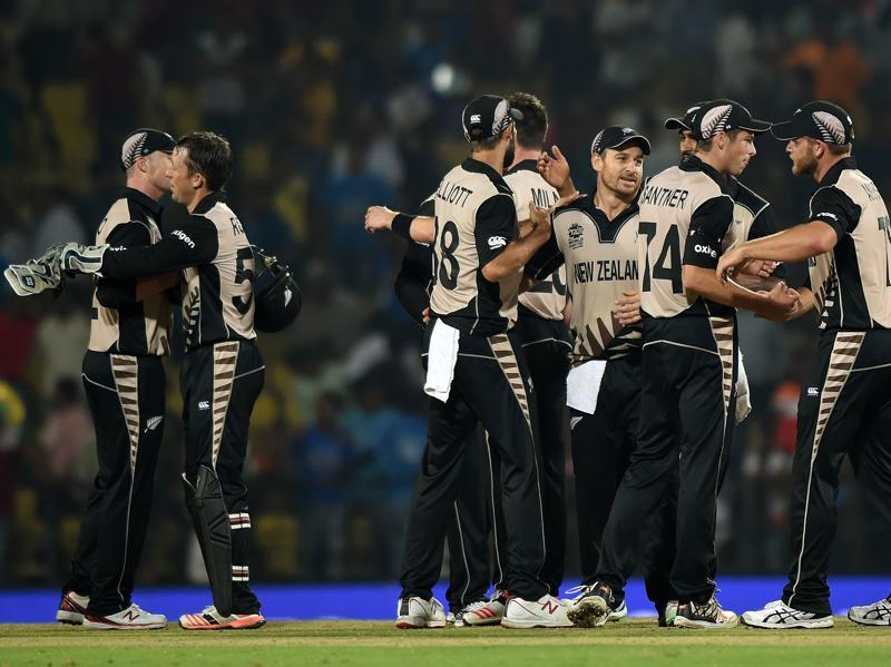 New Zealand players celebrate after winning the World T20 match against India at The Vidarbha Cricket Association Stadium in Nagpur on March 15, 2016. (AFP Photo)