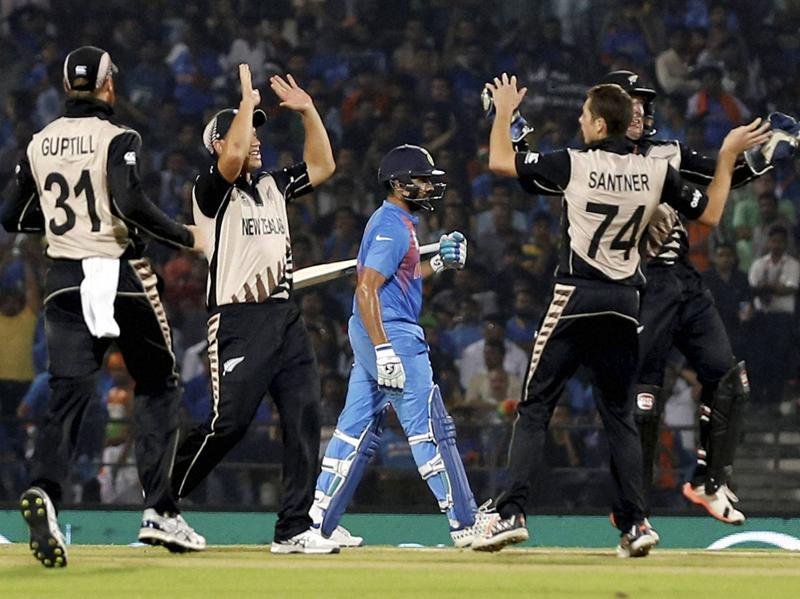 New Zealand players celebrate the wicket of India's Rohit Sharma, who got out stumped. (PTI Photo)