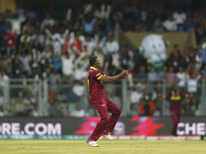 West Indies' Dwayne Bravo does a jig after taking the wicket of England's Ben Stokes. (Reuters Photo)