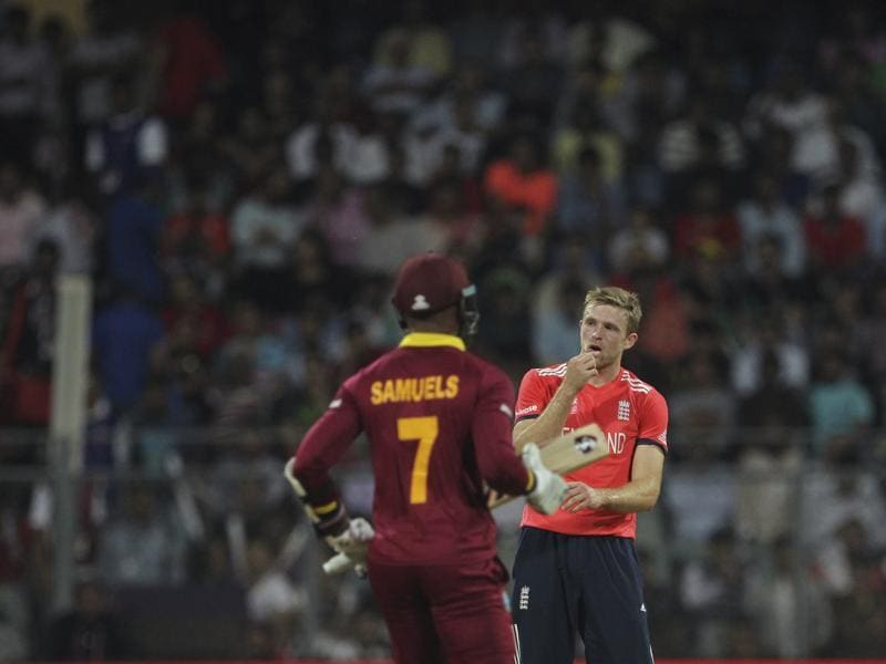 England's David Willey looks on as West Indies' Marlon Samuels takes a single. (AP Photo)