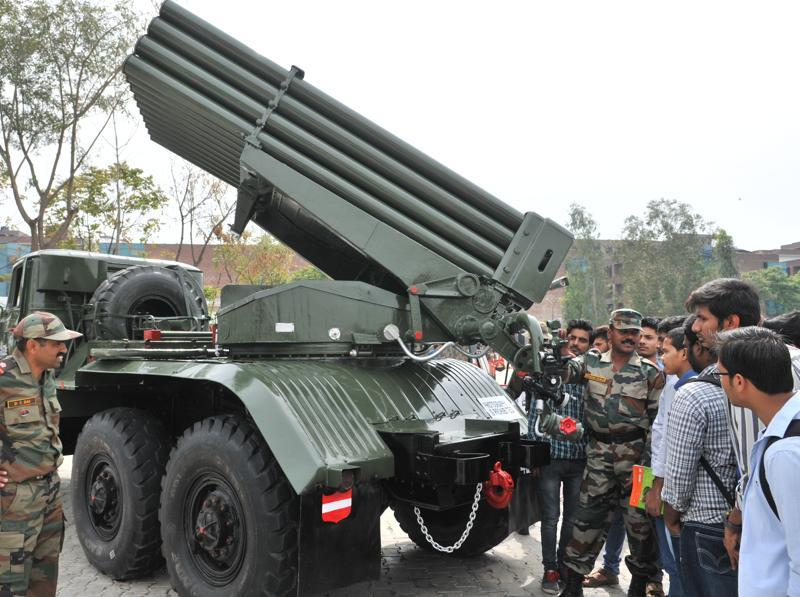 Students being told about missile launching trucks during an army exhibition at Lovely Professional University, on the outskirts of Jalandhar.  (Pardeep Pandit/HT Photo)