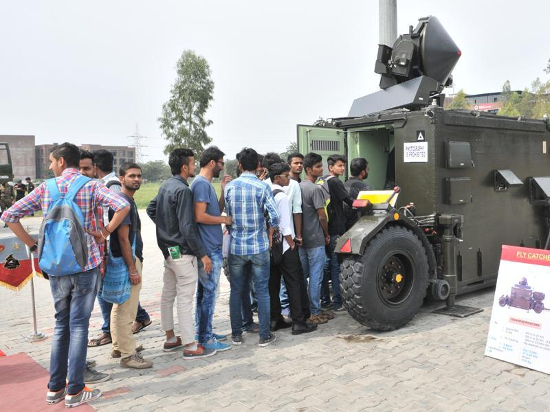 Students wait in a queue to have an in-depth look at a Fly Catcher WPN control system.  (Pardeep Pandit/HT Photo)