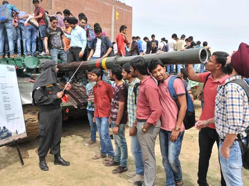 Students take a look at a T-72 M tank during the army exhibition on Wednesday.  (Pardeep Pandit/HT Photo)