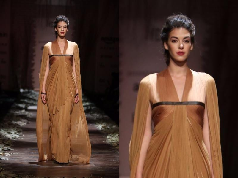 This toffee-caramel coloured ensemble was studded with a cape at Shantanu-Nikhil. (Raajessh Kashyap/HT Photo)