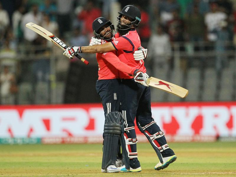 England's Adil Rashid, left, celebrates with Moeen Ali after the winning runs were hit. (AP)