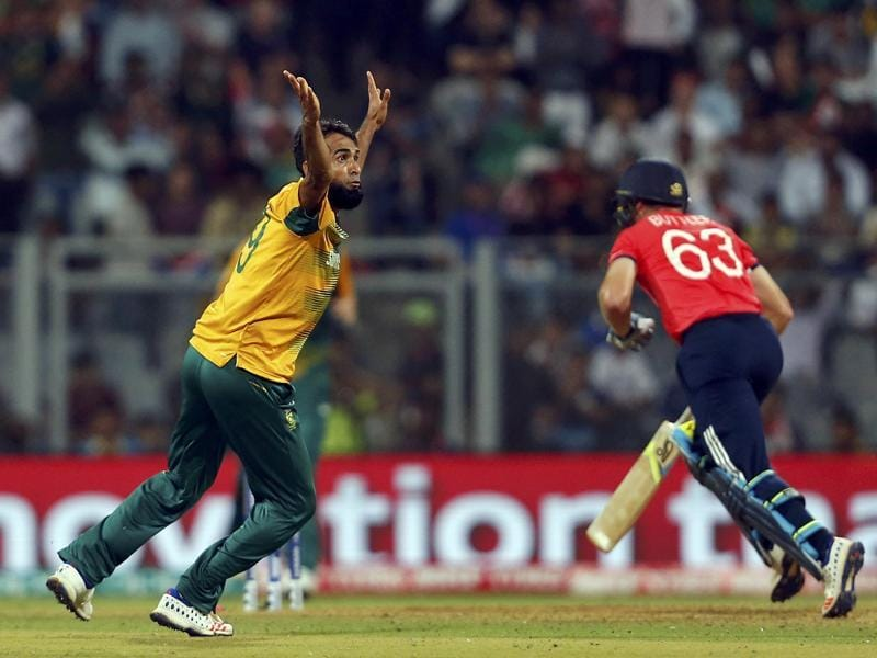 South Africa's Imran Tahir (L) successfully appeals for the wicket of England's Jos Buttler. (REUTERS)