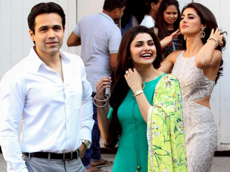 Nargis Fakhri, Emraan Hashmi and Prachi Desai pose for a photoshoot for upcoming biographical film Azhar in Mumbai on March 17, 2016.  (AFP)
