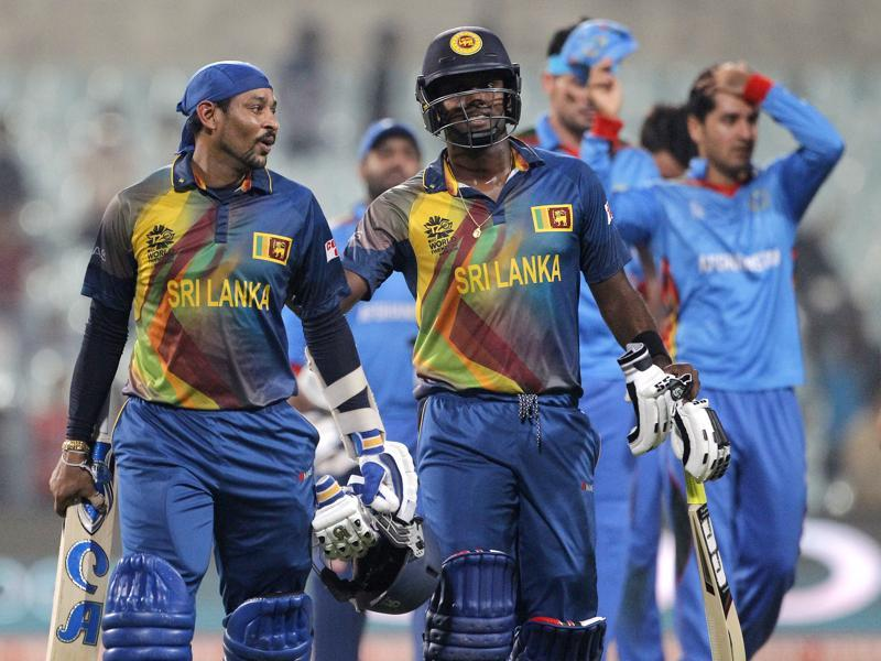 Sri Lanka's Angelo Mathews, right and Tillakaratne Dilshan walk off the field after their win.  (AP)