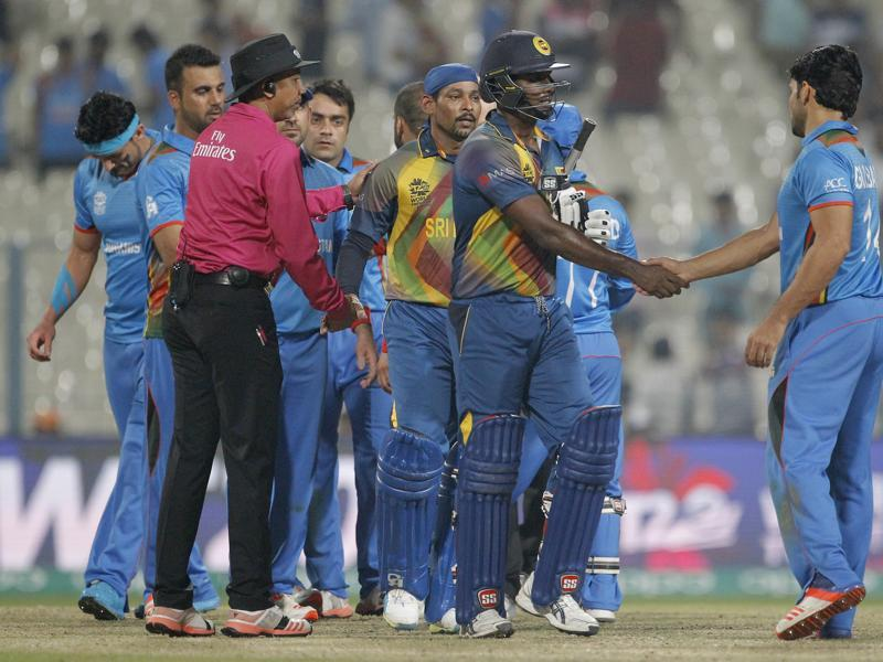 Sri Lanka's Angelo Mathews and Tillakaratne Dilshan shake hands with Afghanistan players after their win. (AP)