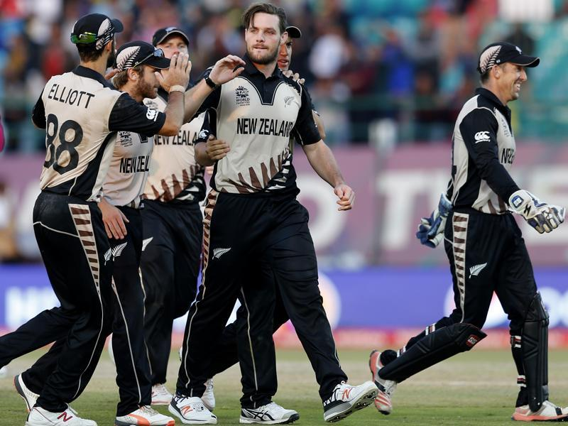 New Zealand's Mitchell McClenaghan is congratulated by teammates after taking a wicket against Australia during their ICC World Twenty20 2016. (AP Photo)