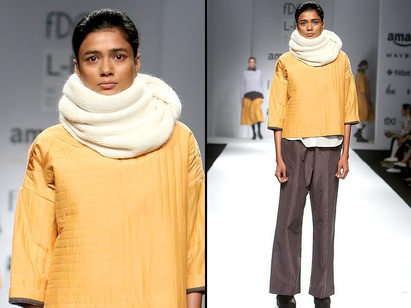 For winters, the snood-neck is bound to keep you stylishly warm. Take your cue from Love Bird runway. (Raajeesh Kashyap/Hindustan Times)