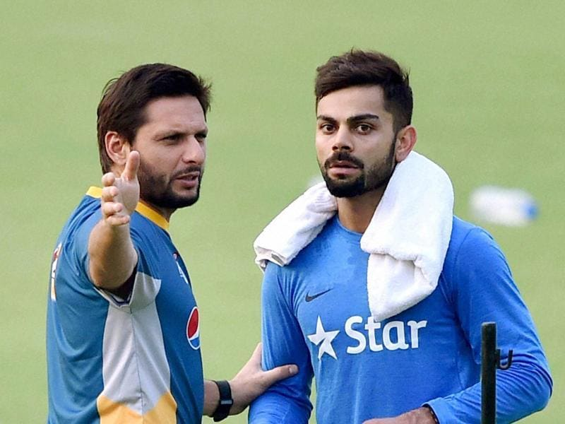 Shahid Afridi and Virat Kohli engaged in a discussion. (PTI  Photo)