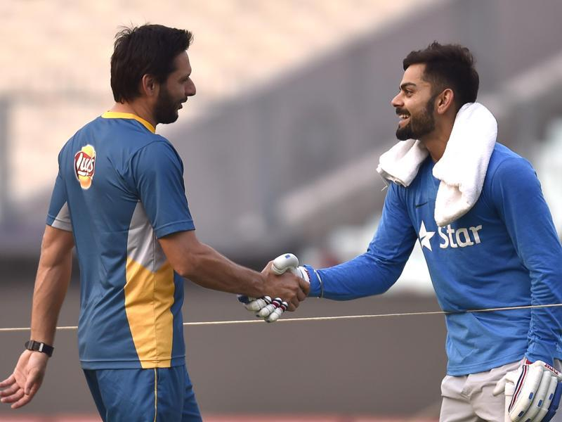 Pakistan captain Shahid Afridi shakes hands with India's Virat Kohli during a practice session at Eden Gardens in Kolkata ahead of their World T20 clash on March 19. (Ajay Aggarwal/HT Photo )