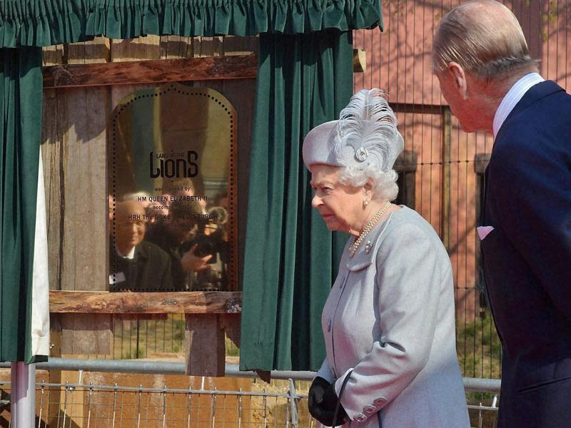 Britain's Queen Elizabeth II and her husband Prince Philip at the London Zoo after the monarch inaugurated a new Asiatic lion exhibit. (PTI Photo)