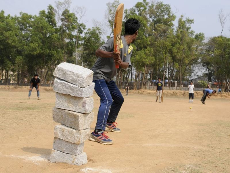 Youth plays cricket at Morhabadi locality in Ranchi. As cricket fever catches India. (Diwakar Prasad/HT Photo)