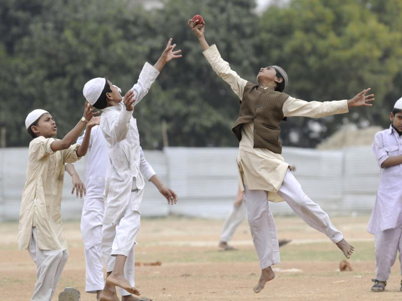 As the T20 World Cup is being aired across TV sets across the country, young boys enjoy a game of cricket as their Madrasa does not have a TV set. (Sunil Ghosh/HT Photo)