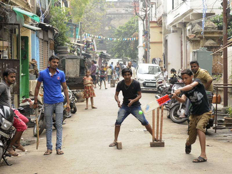 Due to Scarcity of ground, gully (street) cricket is very popular among youth. Here, youngsters are enjoying gully cricket as ICC World T 20 Cup 2016 catches on. (Samir Jana/HT Photo)