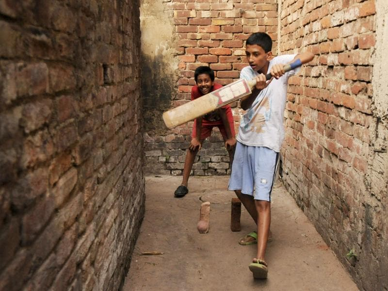 Children play Cricket at BBD Baag as the T20 World cup fever grips India. (Subhankar Chakraborty/HT Photo)