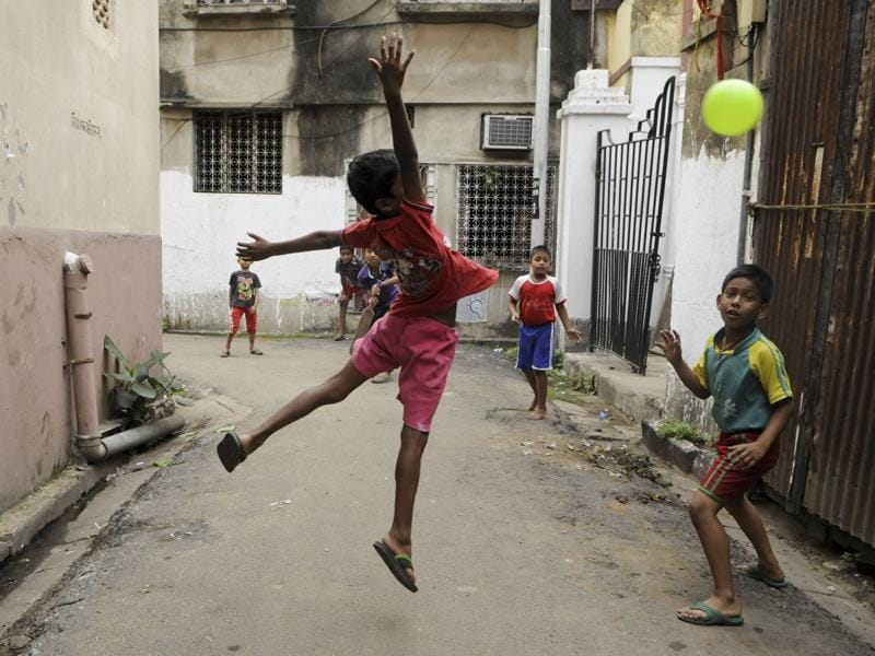 Children sweat it out during a gully cricket tournament as T20 fever catches India.  (Subhendu Ghosh/HT Photo )