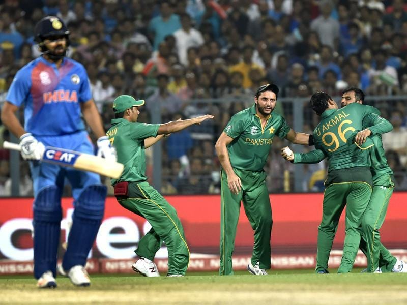 Pakistan team captain Shahid Afridi celebrates the dismissal of Indian player Rohit Sharma . (Ajay Aggarwal/HT PHoto)