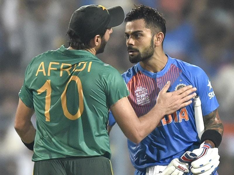 Virat Kohli congratulated by Pakistan team captain Shahid Afridi during ICC World Twenty20 contest between India and Pakistan at Eden Gardens. (Ajay Aggarwal/HT PHoto)