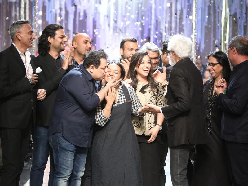 Participant designers celebrate as they take a bow at the grand finale of the fashion week. (Raajessh Kashyap/HT)