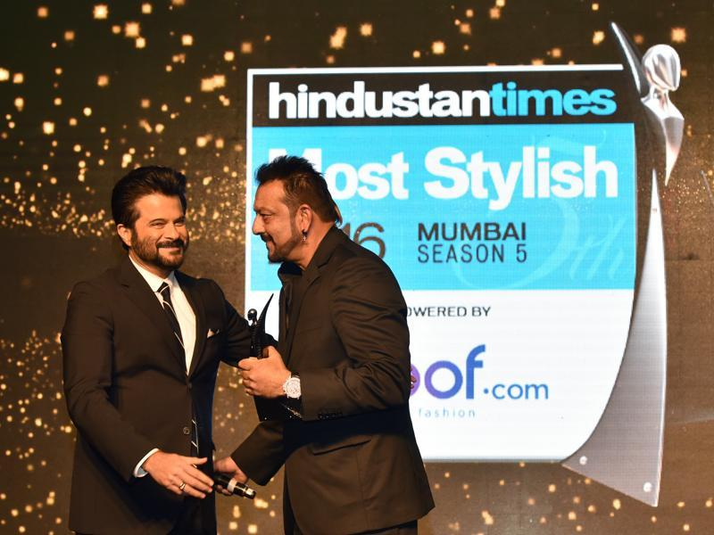 Sanjay Dutt receives an award by Anil Kapoor at HT Most Stylish Awards. (Pratham Gokhale/HT Photo)