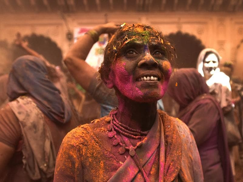 A widow smeared in Gulal takes part in Holi celebrations at Gopinath temple. This time a number of Sanskrit students and Pundits took part in the Holi celebration with widows. (Ajay Aggarwal/HT Photo)
