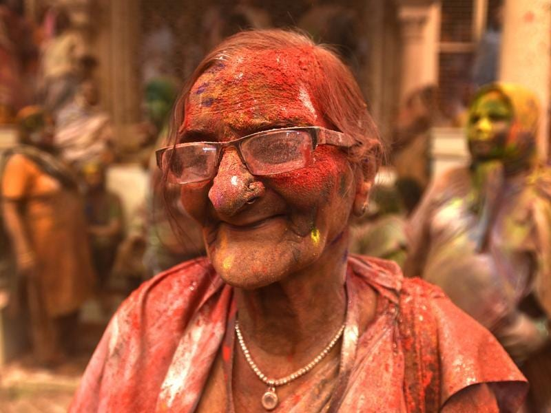 A widow smeared in Gulal takes part in Holi celebrations at Gopinath temple.The widows were highly excited as first time they played Holi inside any temple, marking their further social assimilation. (Ajay Aggarwal/HT Photo)