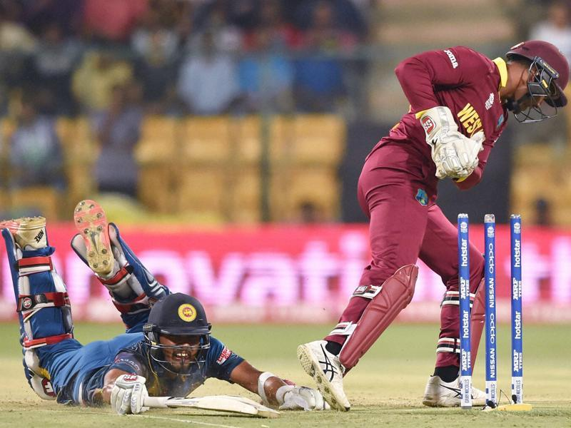 West Indies Wicket keeper Denesh Ramdin runs out Dinesh Chandimal of Sri Lanka during the ICC World T20 match between West Indies and Sri Lanka. (PTI Photo)