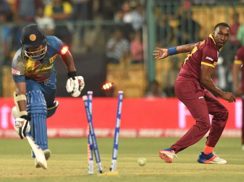 West Indies bowler Dwayne Bravo runs out Rangana Herath of Sri Lanka during the ICC World T20 match between West Indies and Sri Lanka at Chinnaswamy Stadium. (PTI Photo)