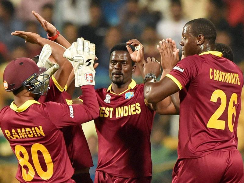 West Indies cricketers celebrate the wicket of Dinesh Chandimal of Sri Lanka during the ICC World T20 match between West Indies and Sri Lanka. (PTI Photo)