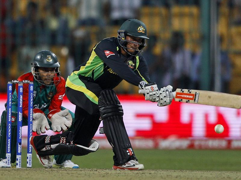Bangladesh's wicketkeeper Mushfiqur Rahim, left, watches Australia's Usman Khawaja play a shot during their ICC World Twenty20 2016 cricket match in Bangalore. (AP Photo)