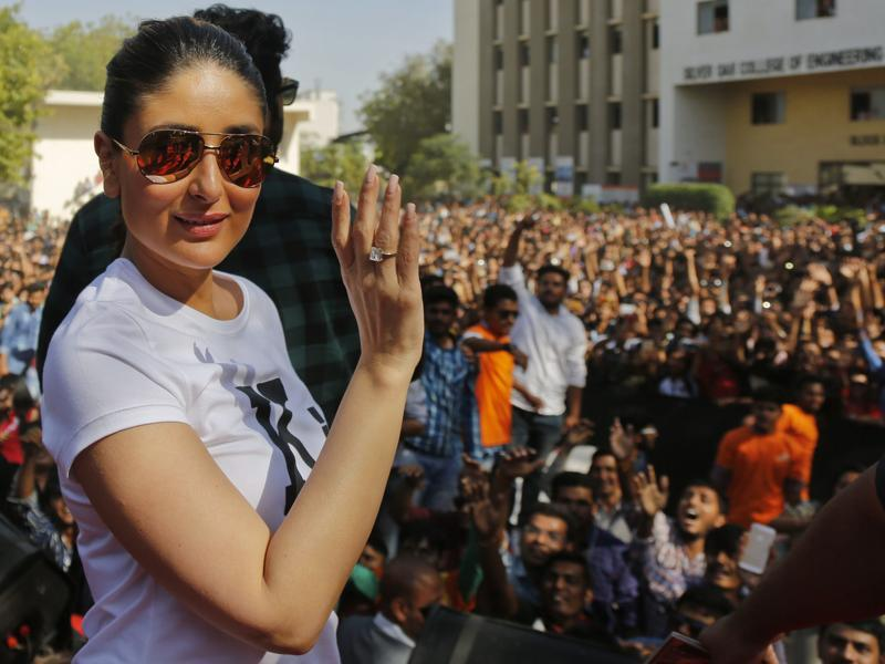 Kareena Kapoor waves to fans during a promotional event for her upcoming movie Ki And Ka in Ahmadabad on March 21, 2016. (AP)