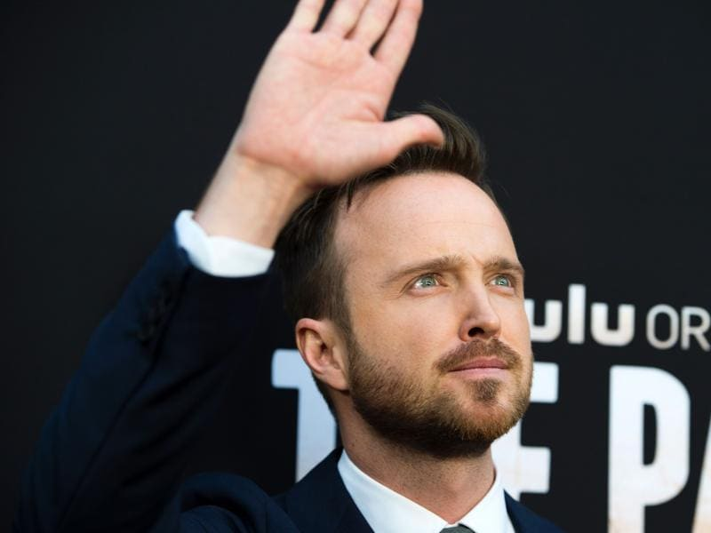 Actor Aaron Paul waves to the crowd at the premiere of Hulu Original The Path. (AFP)