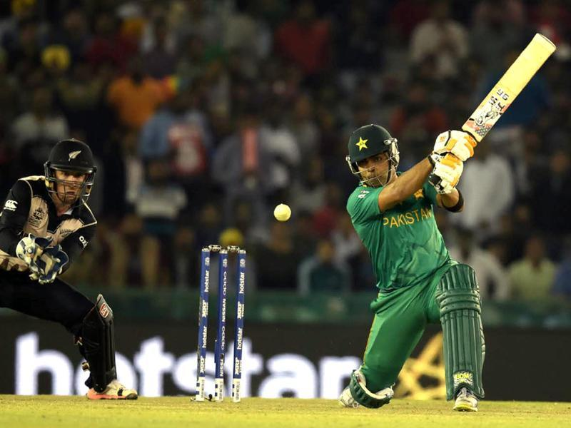 Umar Akmal of Pakistan team play a shot against New Zealand.  (Ravi Kumar/HT Photo)