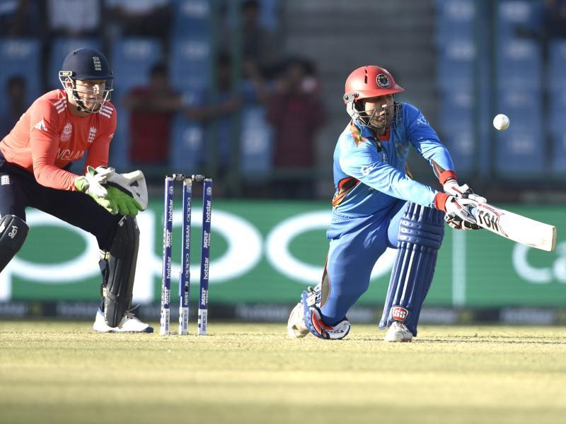 Mohammad Nabi plays a sweep shot. (Mohd Zakir/HT Photo)