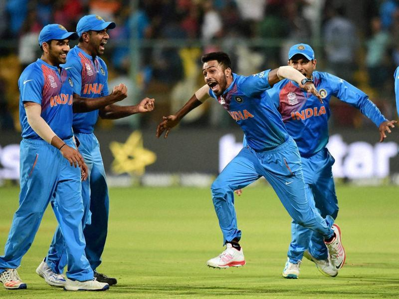India's Hardik Pandya with team mates celebrate the win over Bangladesh during the ICC World T20 match between India and Bangladesh. (PTI Photo)