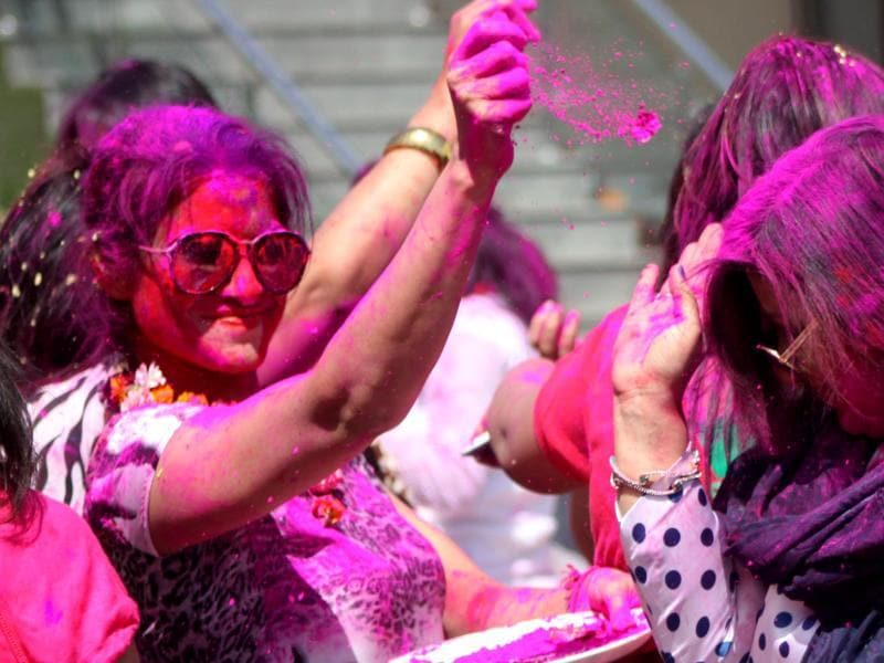 Ladies  enjoying the festival  of colours Holi in Ludhiana .   (JS Grewal/  HT )