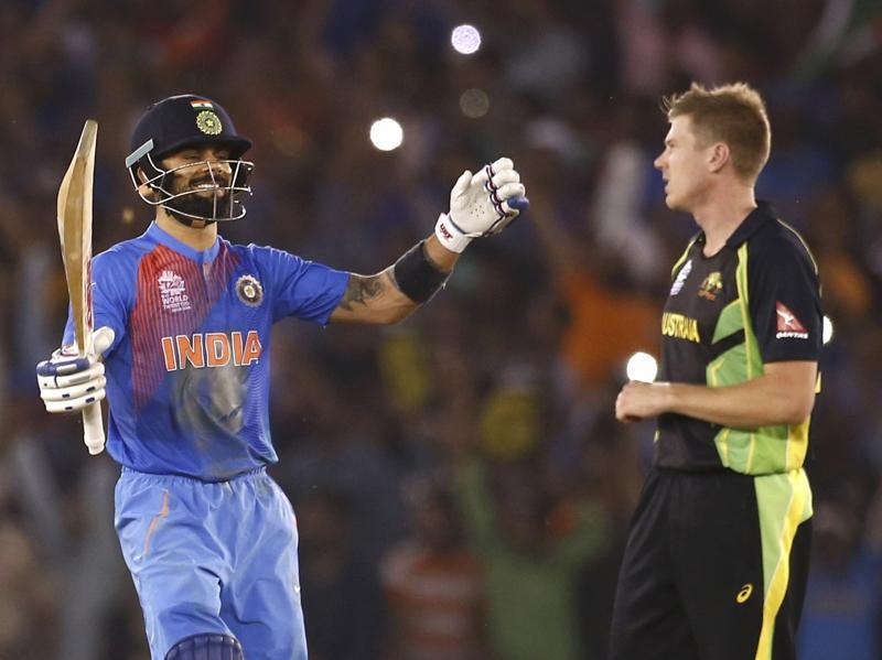 India's Virat Kohli (L) celebrates as Australia's James Faulkner watches after winning the World T20 match in Mohali on March 27, 2016. (REUTERS)