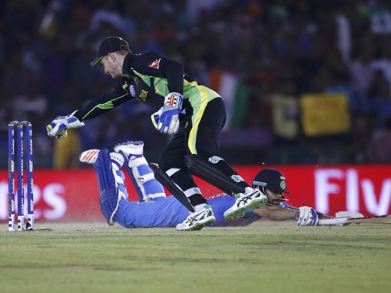 Kohli dives successfully to make his crease as Peter Nevill attempts to run him out.  (REUTERS)