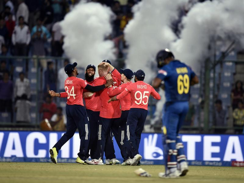 England team members celebrate after their win, which took them into the semifinals of the World T20. (Sanjeev Verma/HT Photo)
