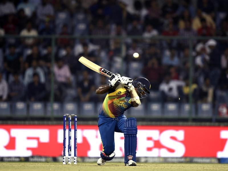 Angelo Mathews ducks to avoid getting hit by a bouncer. (Sanjeev Verma/HT Photo)