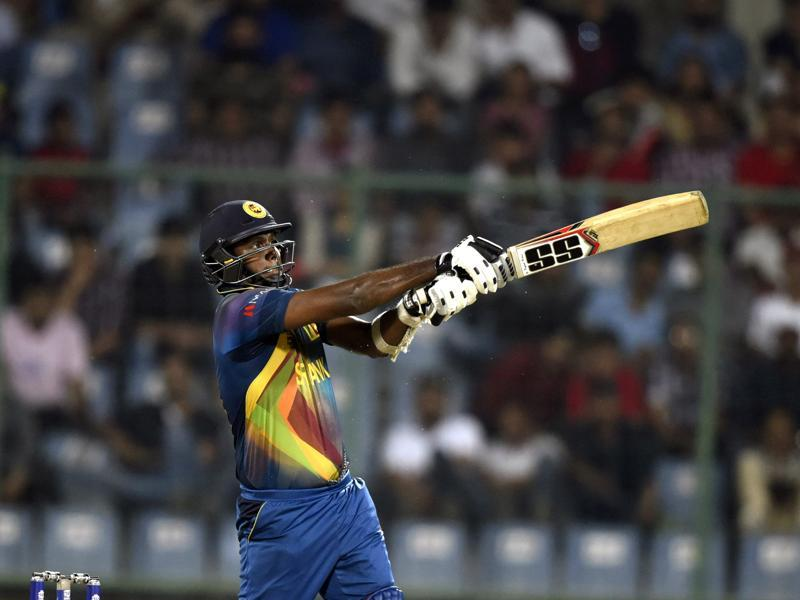 Angelo Mathews whacks one out of the park. (Sanjeev Verma/HT Photo)