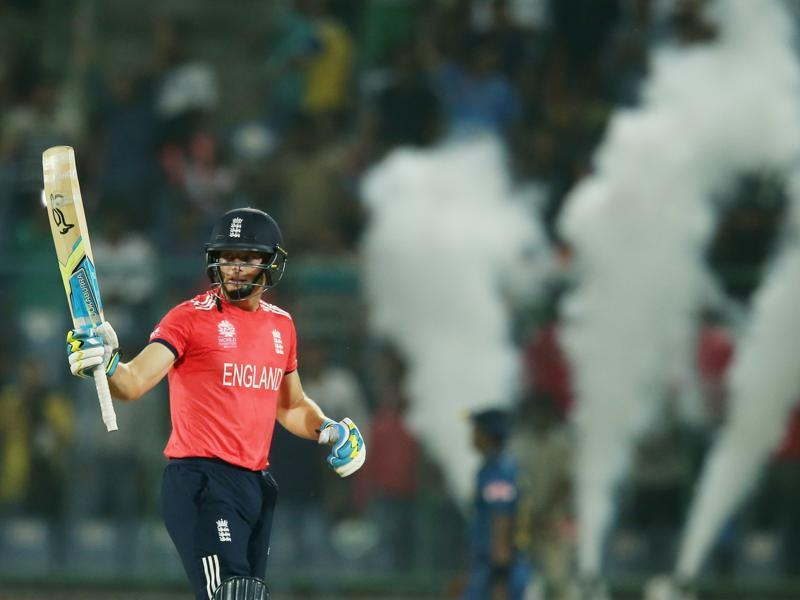England's Jos Buttler waves his bat to the crowd after reaching 50 runs. Buttler was named man of the match for his 37-ball 66. (AP)