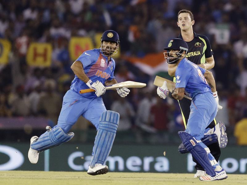 Dhoni, left, and Kohli run between the wickets. (AP)