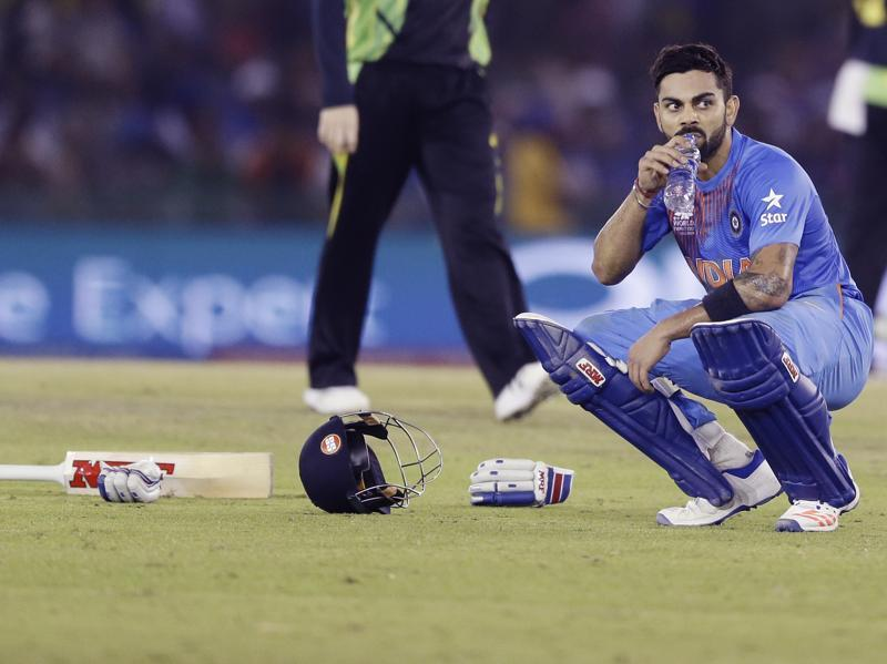 Kohli takes a breather after running two four times in an over. (AP)